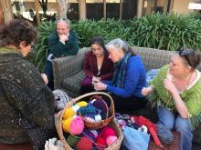 Crocheting the UC Santa Cruz Satellite Reef in the courtyard at Porter college.