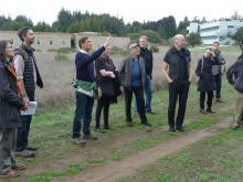 John Barnes, UCSC Campus Architect, makes a point about the site for the new IAS building with architects and landscape architects from New York, San Francisco, Vancouver, and Portland on the March 4th site visit. Photo: John Weber