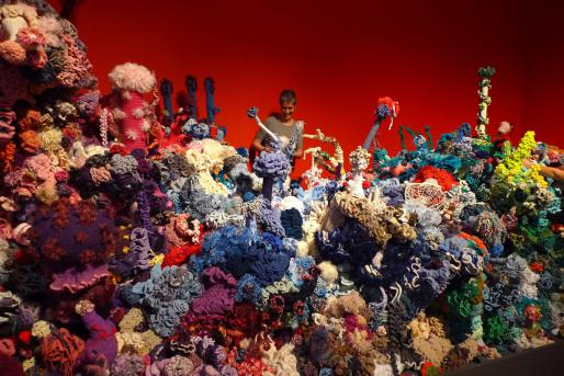 """Crochet Coral Reef,"" with IFF Director Margaret Wertheim in the Föhr Satellite Reef, Museum Kunst der Westküste, Föhr, Germany, 2012. Photo © the Institute For Figuring."