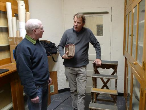 Tony Misch, Lick Archive curator, with Russell Crotty holding E. E. Barnard log books