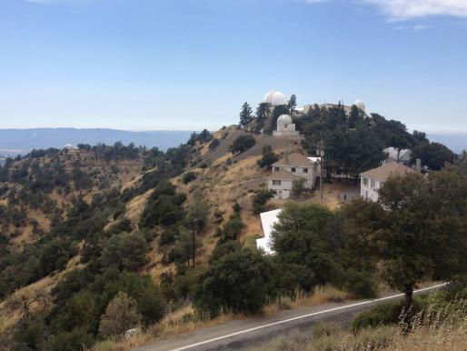 View of Lick Observatory, with housing and dining hall in foreground and Observatory domes in background