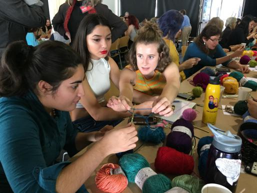IAS intern Lucy Ashton teaches students to crochet at a Crochet Coral Reef Workshop