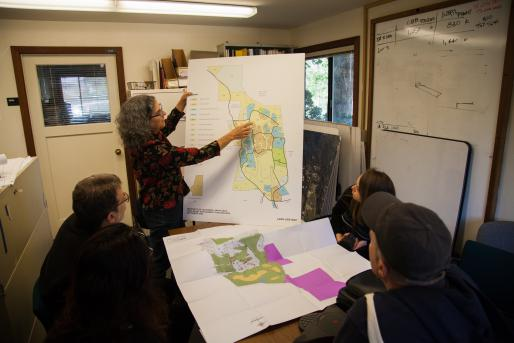 Alisa Klaus, Senior Environmental Planner, shows a campus map to PDW.